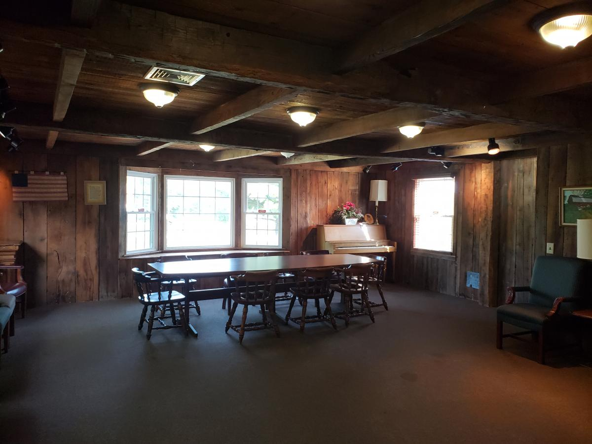 dark room with wood paneling walls